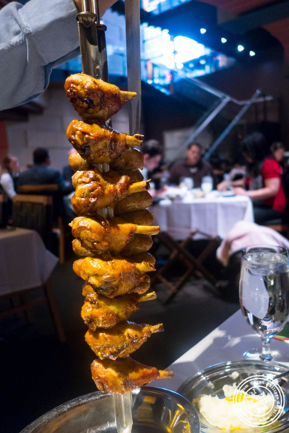 image of chicken legs at Fogo De Chao Brazilian steakhouse in NYC, New York