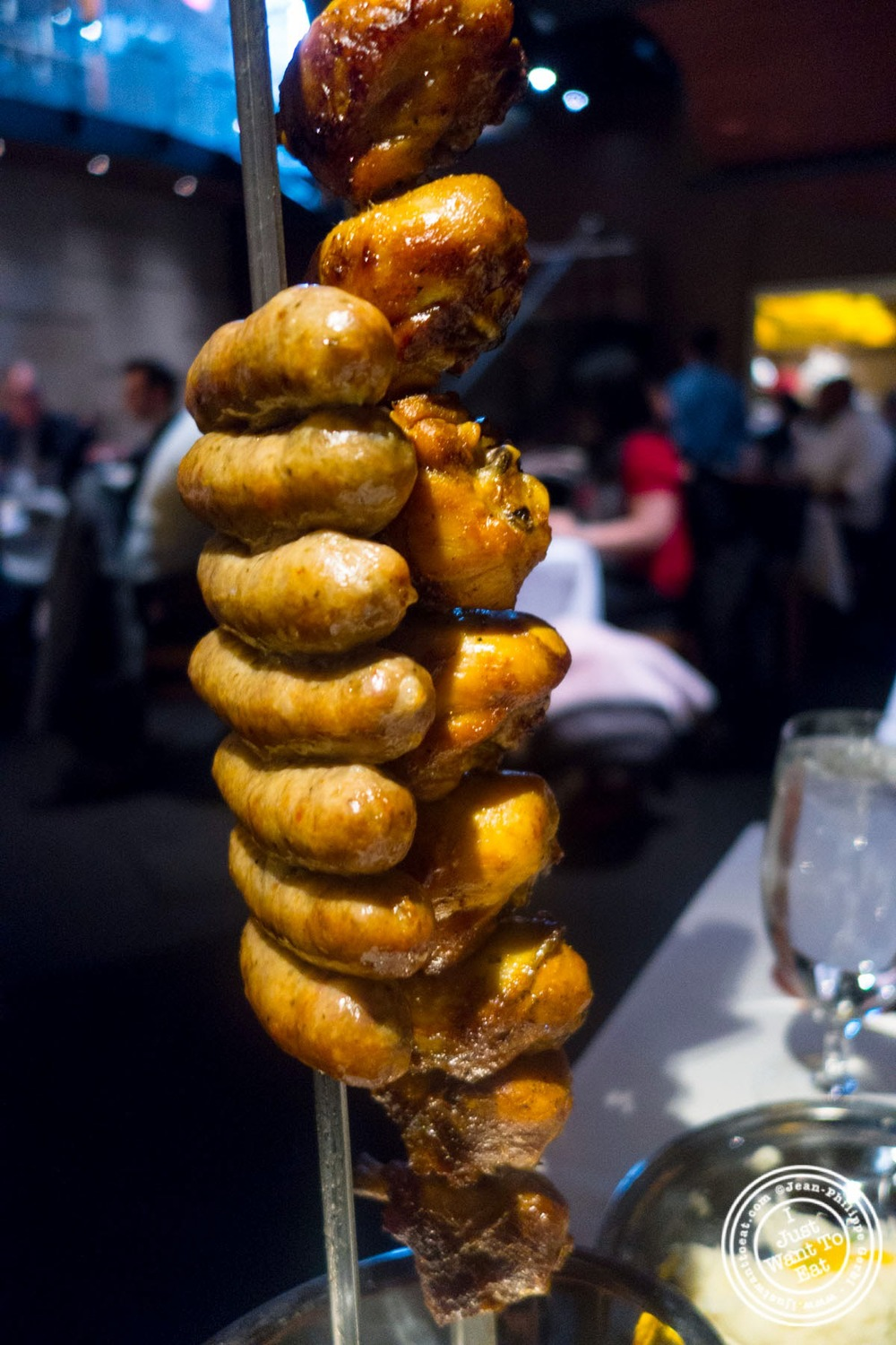image of pork sausage or Linguiça at Fogo De Chao Brazilian steakhouse in NYC, New York
