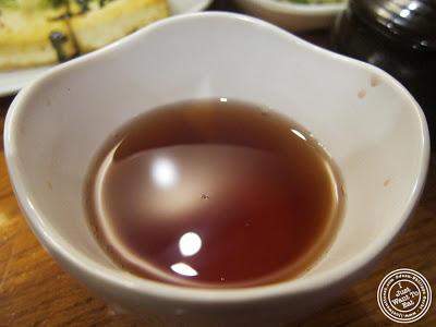 image of cinnamon tea at Kunjip Korean restaurant  in NYC, New York