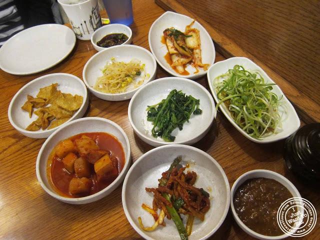 image of banchan at Kunjip Korean restaurant  in NYC, New York