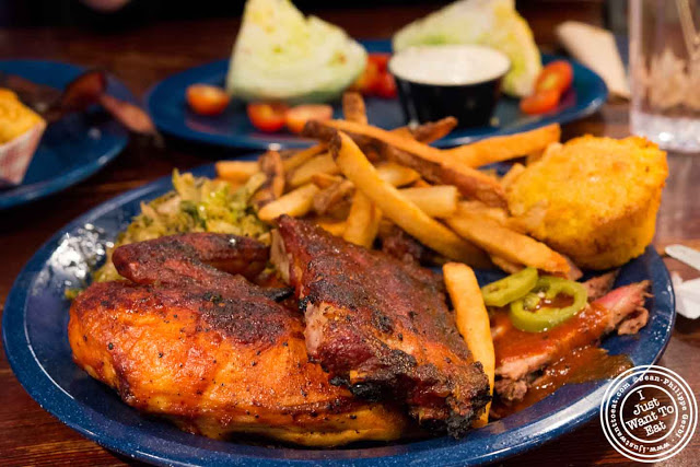 Image of chicken, ribs and brisket at  Dinosaur BBQ in Harlem NYC, New York