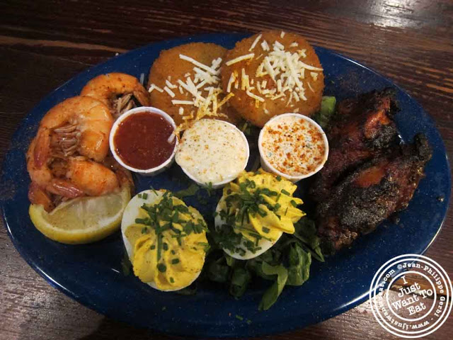 Image of Appetizer sampler plate at  Dinosaur BBQ in Harlem NYC, New York