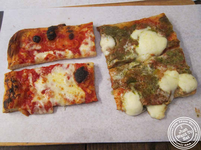 Image of plain pizza and Tricolore (Basil pesto and mozzarella di buffala) at Pizza Roma in NYC, New York