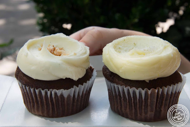 image of chocolate cake with coconut icing and vanilla cake with lemon icing Cupcake at Butter Lane in the East Village, NYC, New York
