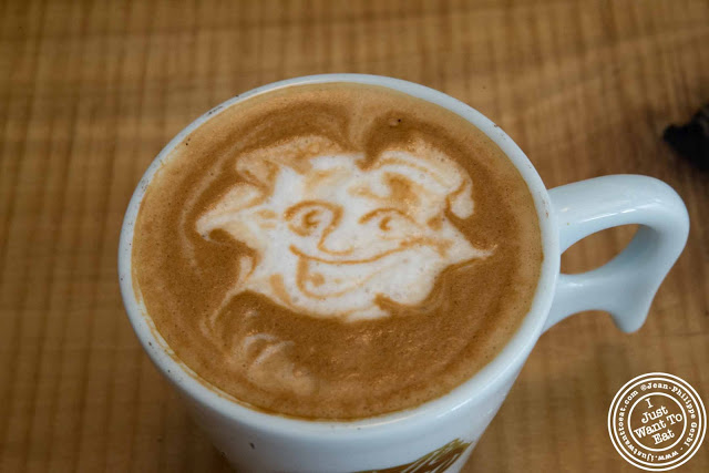 image of portrait on latte at Little Fox Cafe in Chinatown, NYC, New York