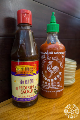 image of Hoisin and siracha sauces at Pho Nomenon in Hoboken, NJ