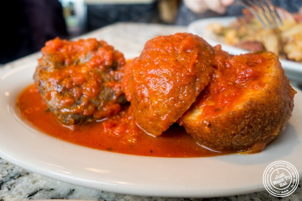 image of meatballs and rice balls in tomato sauce at Rosticeria Da Gigi in Hoboken, NJ