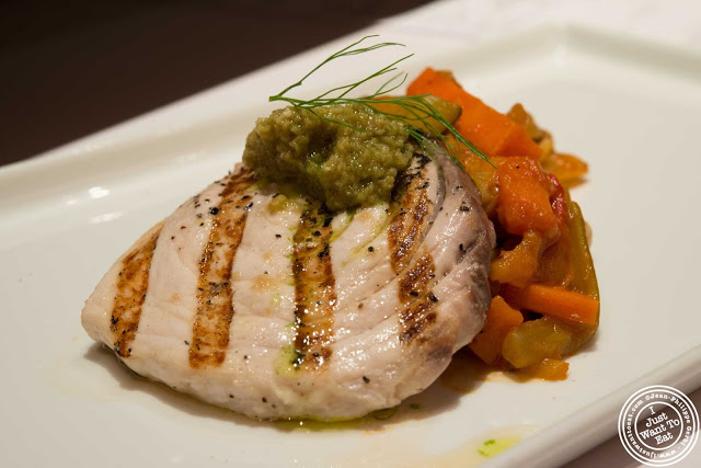 image of grilled swordfish, Castelvetrano tapenade and Sicilian caponata at Aroma Kitchen and Wine Bar