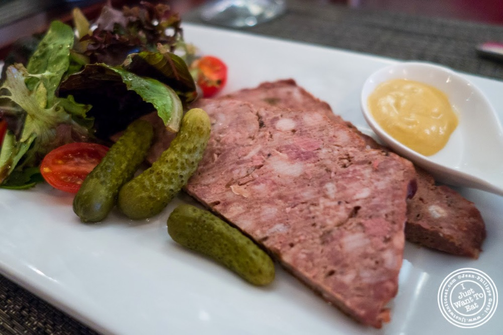 Homemade pâté with cornichons at Paname, French restaurant in New York, NY