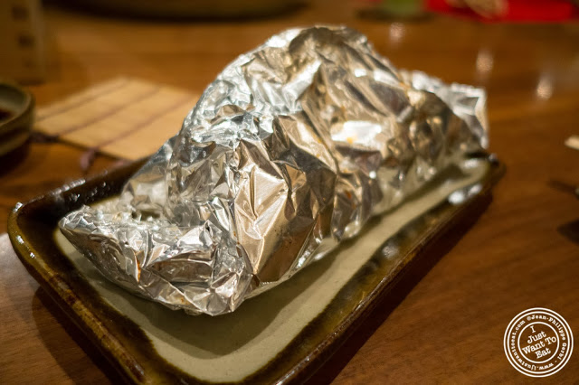 image of grilled mushrooms in foil at Inakaya in Times Square, NYC, New York