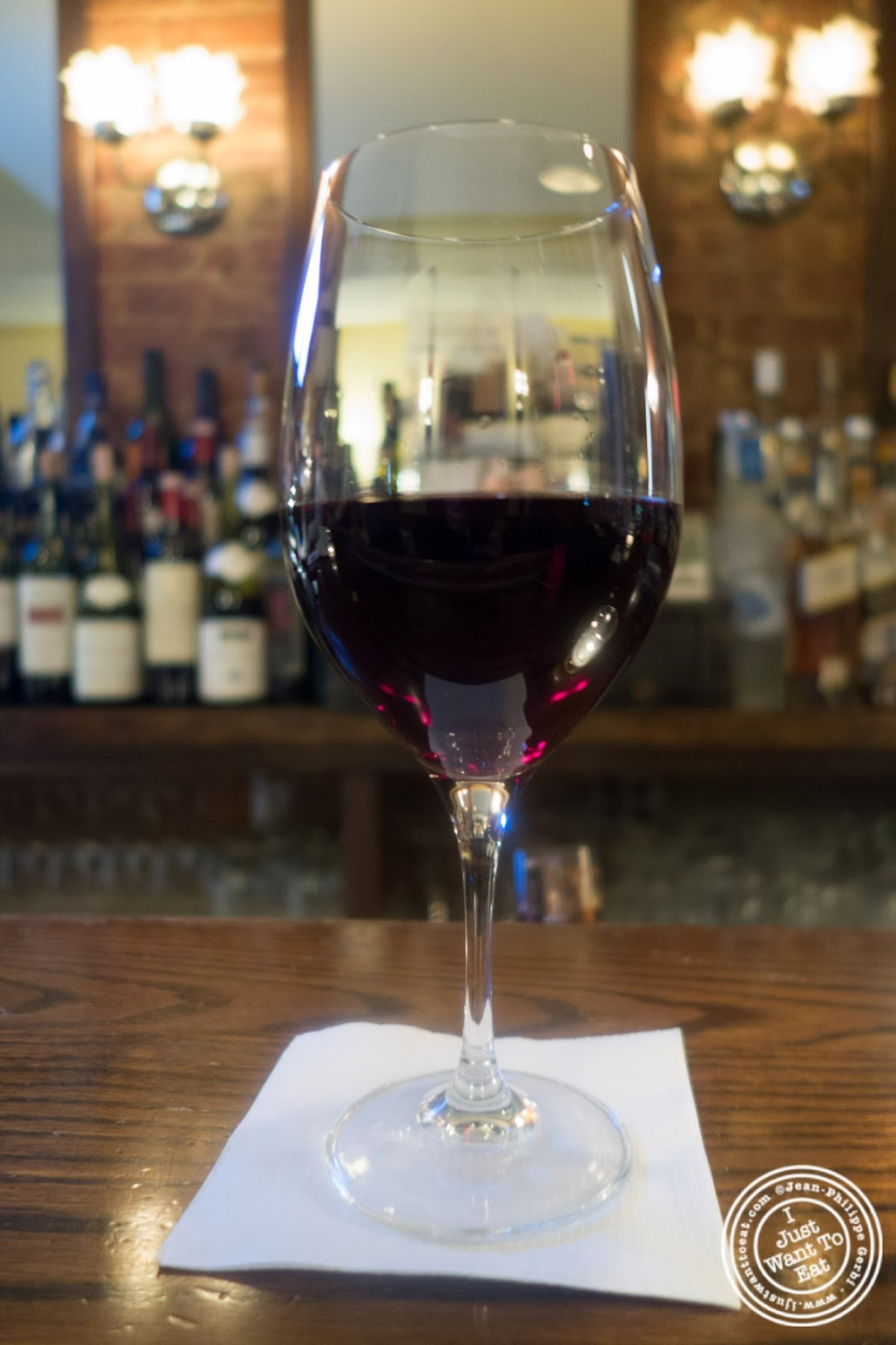image of glass of Brouilly at Sel et Poivre on the Upper East Side, NYC, New York