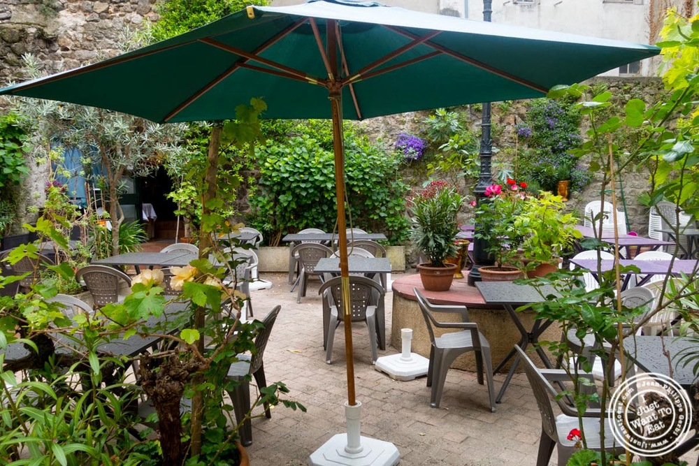 image of terrace at Le Chaudron in Tournon, France