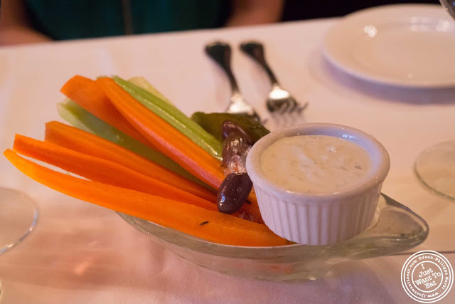 image of veggies and blue cheese sauce at Keens Steakhouse in NYC, New York