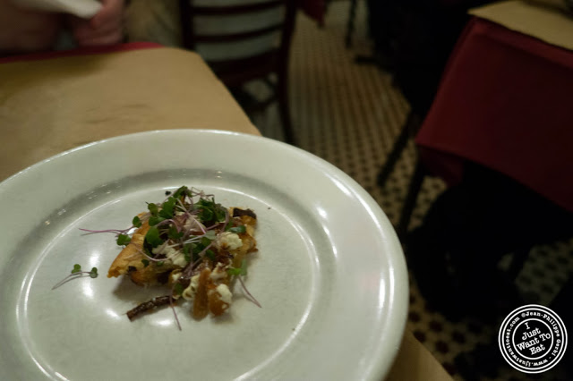 image of caramelized onions and goat cheese tart at  Dark Dining Projects - blindfolded dinner at Camaje bistro in Greenwich Village, NYC, New York