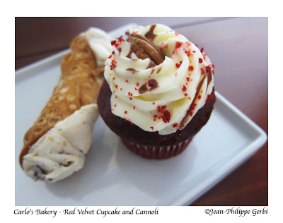 Image of Red Velvet cupcake and cannoli at Carlo's Bakery in Hoboken, NJ - The Cake Boss