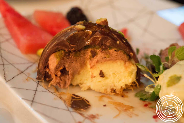 Image of Ekmek valrhona chocolate dome at Thalassa Greek restaurant in Tribeca NYC, New York