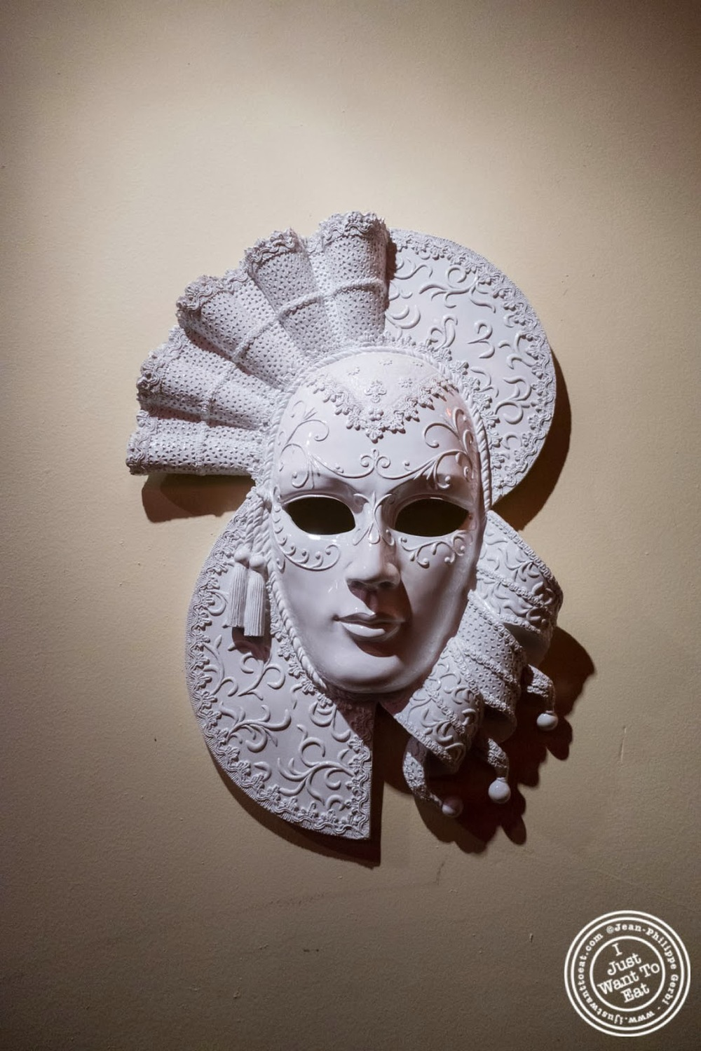 image of Mardi gras mask at MASQ New Orleans inspired cuisine in NYC, New York
