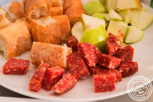 Image of Apple, bread and salami at the Vintner Wine Market in NYC, New York - Hell's Kitchen