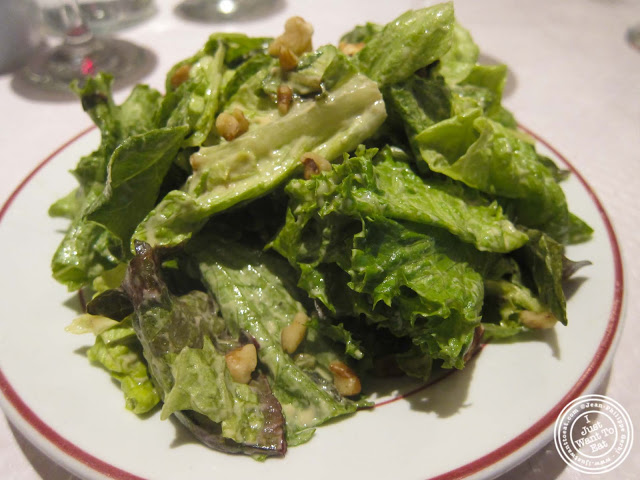 image of green salad and walnuts at Le Relais de Venise in NYC, New York