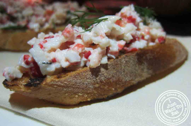 Image of King Crab with Piquillo pepper Bruschetta at Courgette next to Dream Hotel Midtown in NYC, New York
