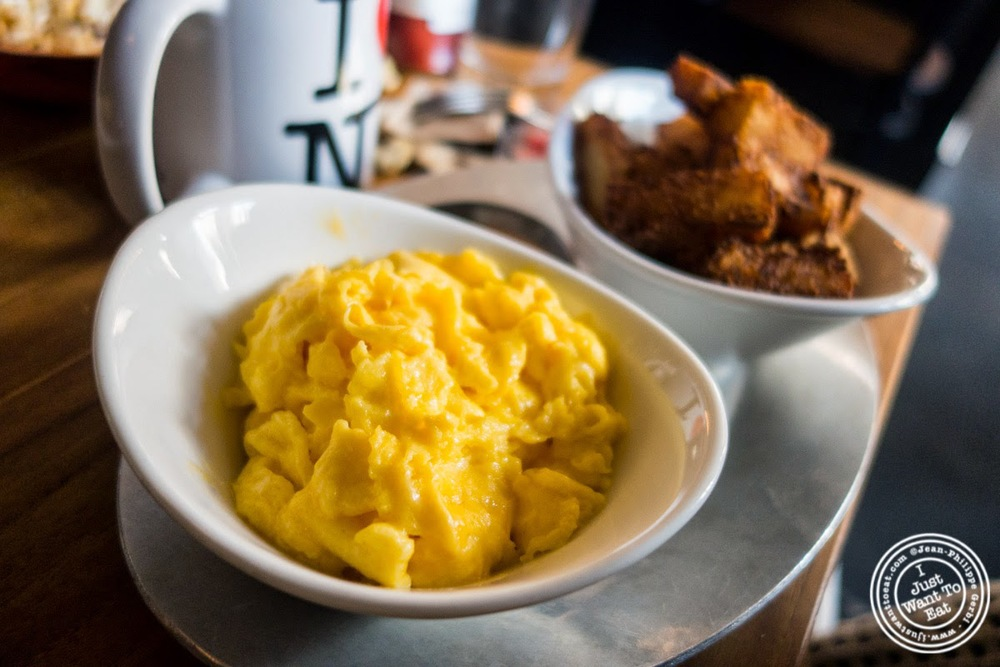 image of scrambled eggs and tater tots at Distilled in Tribeca, NYC, New York