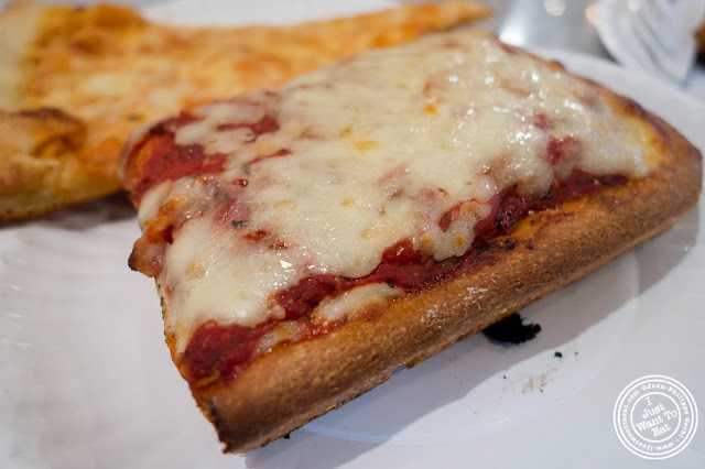 image of Sicilian slice at Famous Ben's pizza in Soho, NYC, New York
