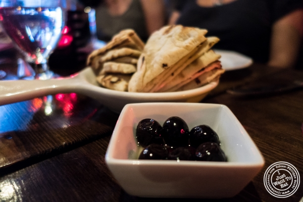 Olives and pita at Pierre Loti Wine Bar in New York, NY