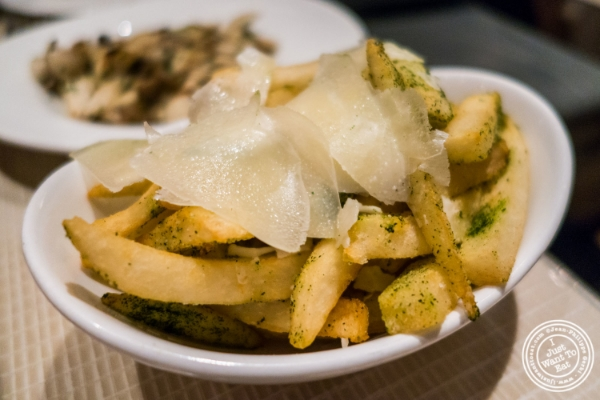 French fries with herbs and shaved parmesan at Maze by Gordon Ramsay in New York, NY