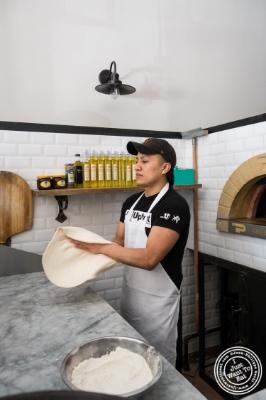 Making pizza atVia Vaiin Astoria, NY