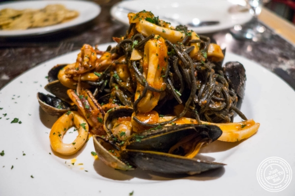 Black linguine with seafood at Petrarca Cucina e Vino, Italian restaurant in Tribeca, NYC, New York