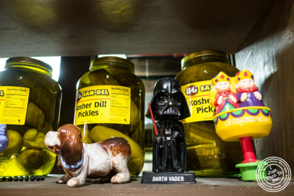 Pickles and figurines at Burger Joint W8th Street in NYC, New York