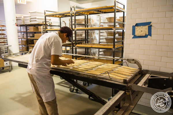 Preparing bread at  Breads bakery in NYC, New York