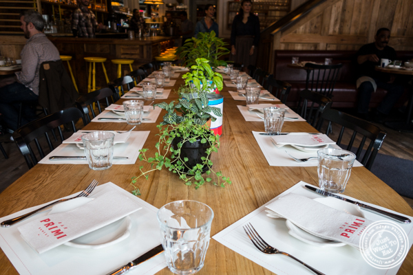 Communal table at Bar Primi in NYC, New York