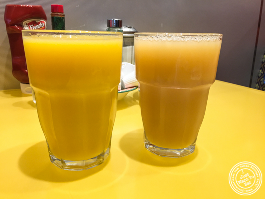 Fresh squeeze orange and grapefruit juices at Tick Tock Diner in NYC, New York