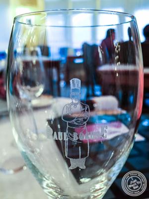 Glass of wine at L'Auberge du Pont de Collonges of Paul Bocuse in France