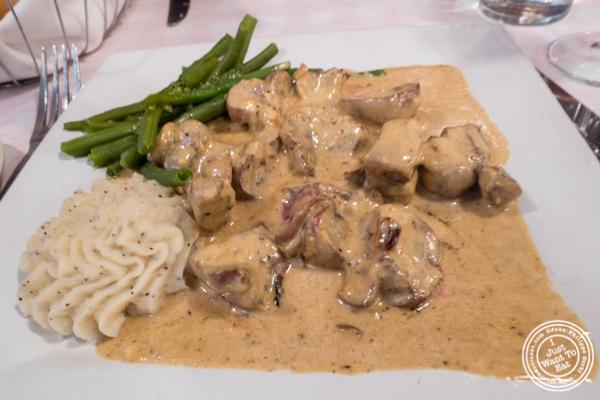 Veal kidneys å la moutarde at Tout Va Bien, French Restaurant in NYC, New York