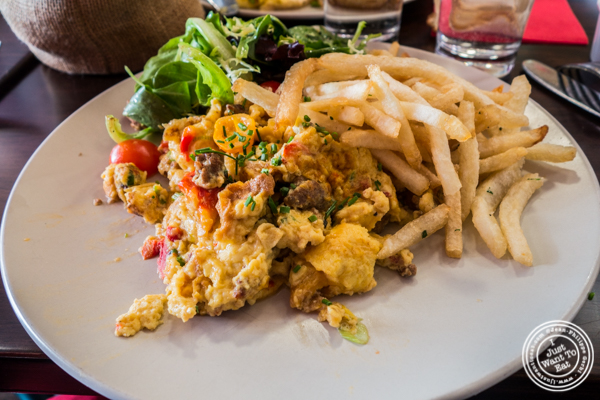 Scrambled eggs with merguez at Amelie Wine Bar in NYC, New York