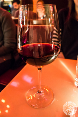 Glass of Bourgogne rouge, domaine Seguin-Manuel 2013 at Amelie Wine Bar in NYC, New York