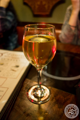 Glass of Pinot Grigio at Taureau, French restaurant in the West Village, NYC, New York