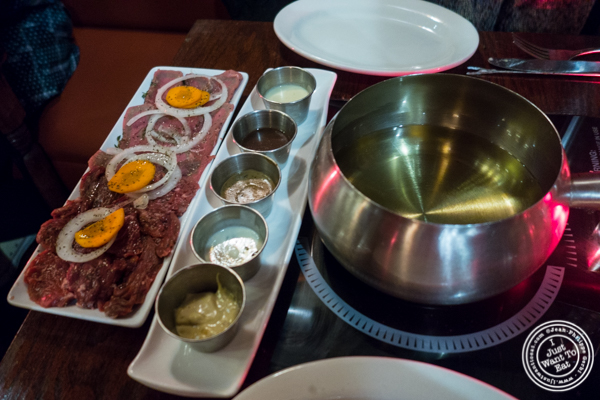 Fondue Bourguignonne at at Taureau, French restaurant in the West Village, NYC, New York