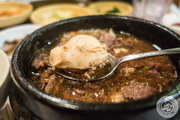 Egg in bulgogi jiggae at Cho Dang Gol, Korean restaurant in NYC, New York