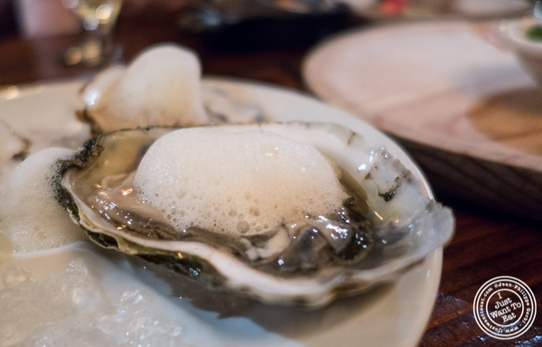 Oyster with lemon foam at Nai Tapas Bar in the East Village