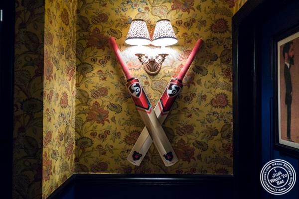 Cricket bats at The Royal Munkey in NYC, New York