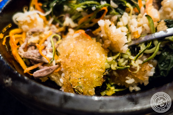 Rice crust in Yookhwe bibimbap at Hell's Chicken in NYC, New York