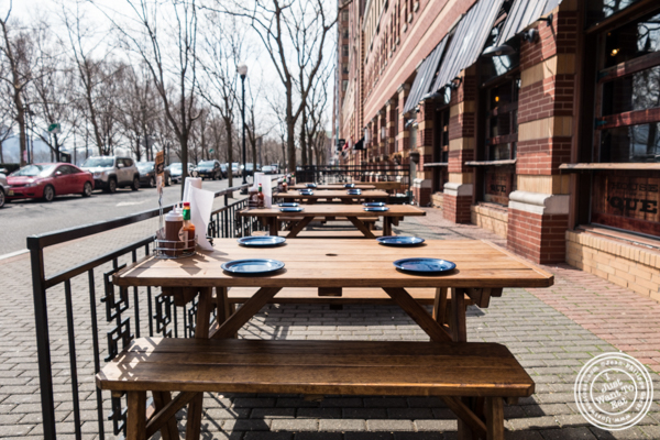 Outdoor dining area at House of Que in Hoboken, NJ