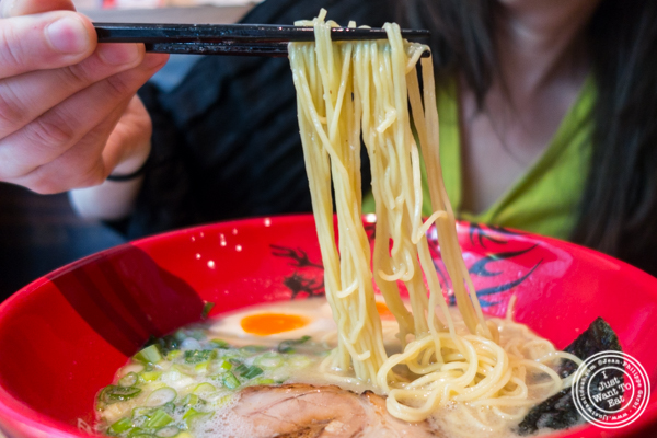 Thin straight noodles in Ajitama ramen at Ramen Zundo-Ya in NYC, New York