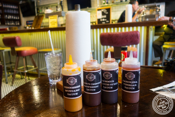 Sauces and paper towel at Sammy's House of BBQ in Times Square, NYC