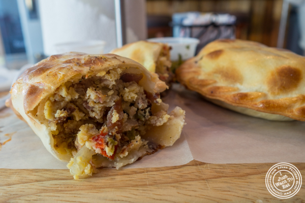 Eggs, bacon, cheese, peppers and onions empanada at Empanadas Café in Hoboken, NJ