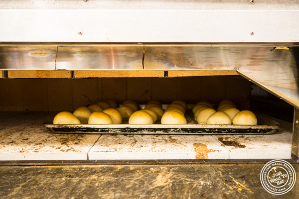 Cooking the bread in the brick oven at ORO, Italian restaurant in Long Island City