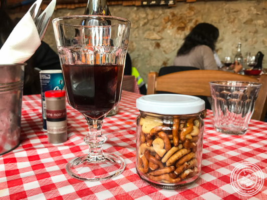Walnut wine and crackers at La Ferme à Dédé in Sassenage, France